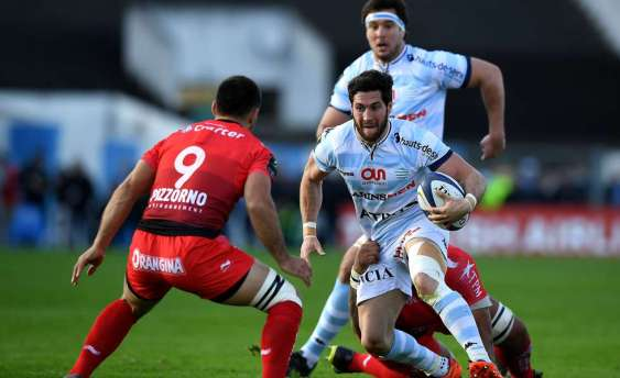 RC Toulon's French scrumhalf Jonathan Pelissie (L) vies with Racing Metro 92 French scrumhalf Maxime Machenaud during the European Rugby Champions Cup match between Racing Metro 92 and Toulon at Yves du Manoir stadium in Colombes on April 10, 2016. AFP PHOTO / FRANCK FIFEFRANCK FIFE/AFP/Getty Images