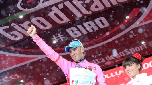 Italian cyclist Vincenzo Nibali and leader of the pack wears the pink jersey as he celebrates his victory on the podium after winning the 210 km-long 20th stage of 96th Giro d'Italia from Silandro to Tre Cime di Lavaredo, on May 25, 2013, in Tre Cime di Lavaredo. AFP PHOTO / LUK BENIES (Photo credit should read LUK BENIES/AFP/Getty Images)